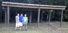 """<div class=""""source"""">courtesy of the Reeves family</div><div class=""""image-desc"""">The Reeves triplets, from left, Walker, Jackson and Grey, stand in front of the horse shelter Jackson built at the Anne Springs Close Greenway for his Eagle project.</div><div class=""""buy-pic""""></div>"""