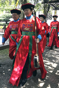"<div class=""source"">supplied</div><div class=""image-desc"">One of the local visitors snapped this photo of musicians in traditional garb.</div><div class=""buy-pic""></div>"