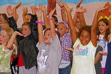 """<div class=""""source"""">courtesy of Frank DeLoache</div><div class=""""image-desc"""">Students rehearse a musical number for Camp Vivace's 2017 production.</div><div class=""""buy-pic""""></div>"""